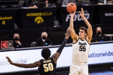 Iowa forward Luka Garza takes a shot against Purdue at Carver-Hawkeye Arena on Tuesday.