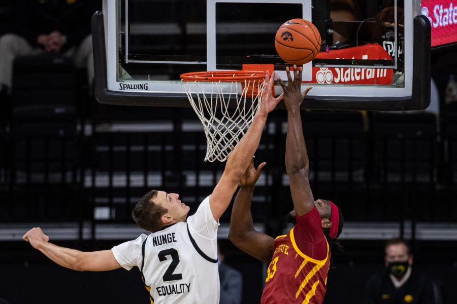 Iowa forward Jack Nunge defends during a men's basketball game between Iowa and Iowa State at Carver-Hawkeye Arena on Friday, Dec. 11, 2020. The Hawkeyes defeated the Cyclones, 105-77.