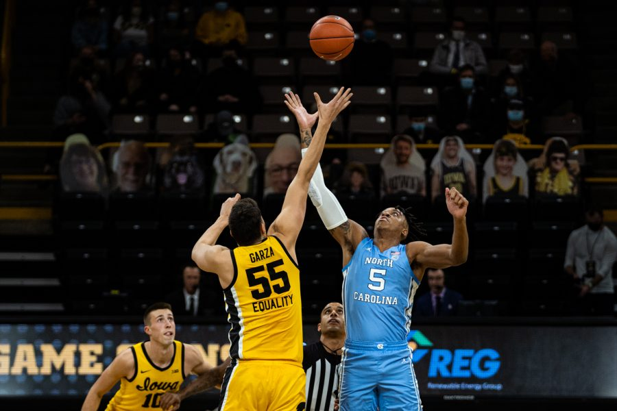 Players tip-off during a men's basketball game between Iowa and North Carolina at Carver-Hawkeye Arena on Tuesday, Dec. 8, 2020.