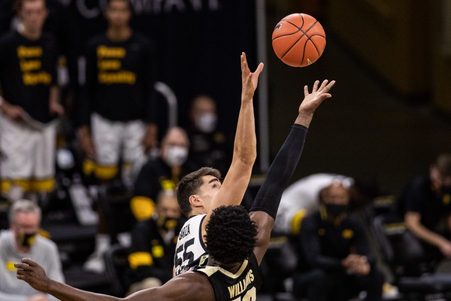 Players tip off during a men's basketball game between Iowa and Purdue at Carver-Hawkeye Arena on Tuesday, Dec. 22, 2020.