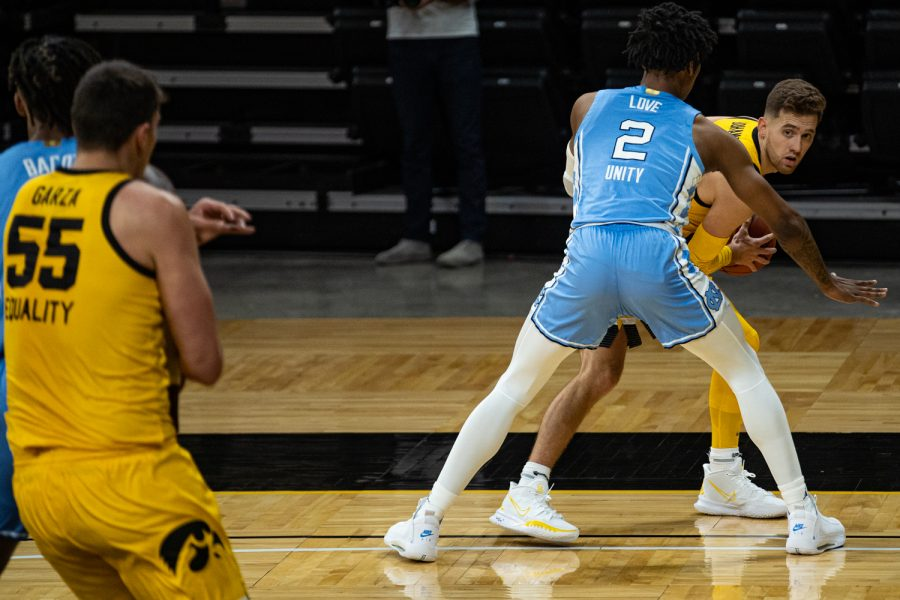 Iowa guard Jordan Bohannon looks to pass during a men's basketball game between Iowa and North Carolina at Carver-Hawkeye Arena on Tuesday, Dec. 8, 2020. Bohannon led the team with 24 points.