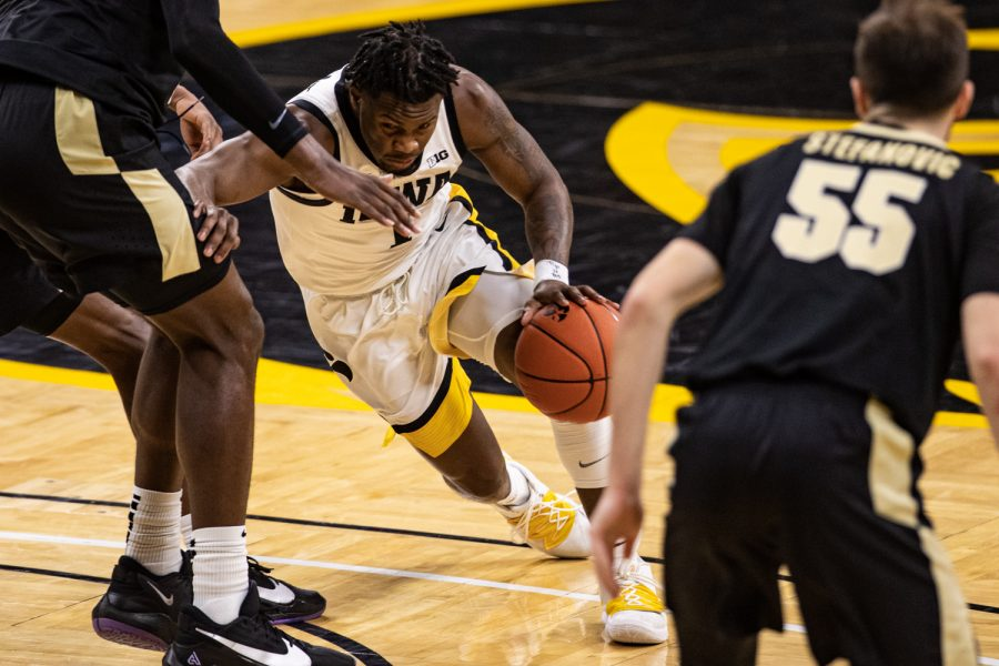 Iowa guard Joe Toussaint drives forward during a men's basketball game between Iowa and Purdue at Carver-Hawkeye Arena on Tuesday, Dec. 22, 2020. Toussaint finished with four assists.