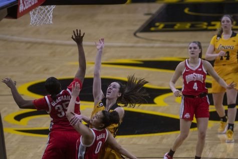 Iowa guard Caitlin Clark attempts to shoot a basket during a women