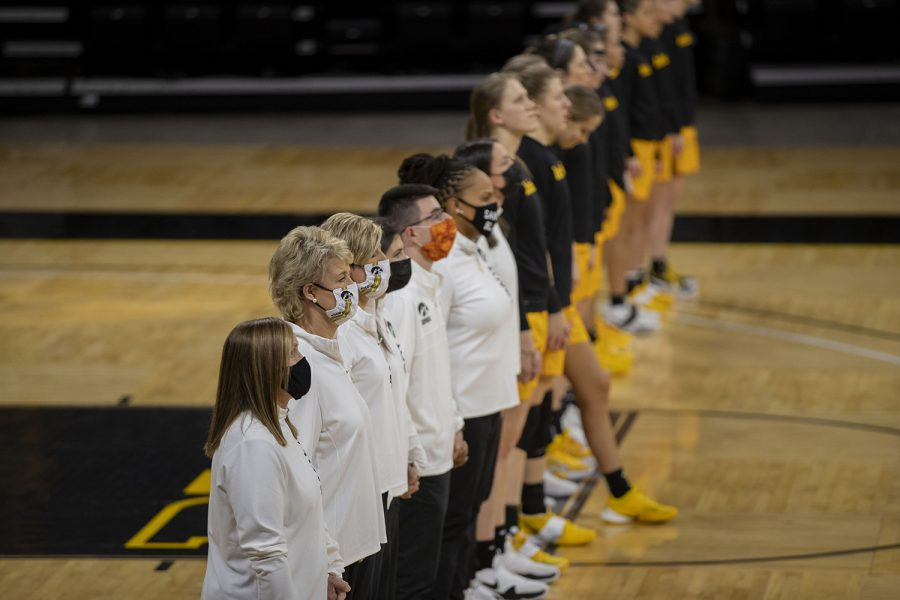 Iowa+coaches+and+players+stand+during+the+national+anthem+before+a+women%27s+basketball+game+against+Ohio+State+on+Wednesday%2C+Jan.+13%2C+2021+at+Carver+Hawkeye+Arena.+The+Hawkeyes+were+defeated+by+the+Buckeyes+in+overtime%2C+82-84.