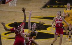 Iowa guard Caitlin Clark attempts to shoot a basket during a women's basketball game against Ohio State on Wednesday, Jan. 13, 2021 at Carver Hawkeye Arena. The Hawkeyes were defeated by the Buckeyes in overtime, 82-84.