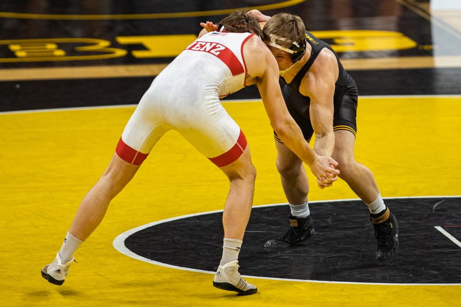 Iowa's 184-pound Nelson Brands grapples with Nebraska's Taylor Venz during a wrestling dual meet between No. 1 Iowa and No. 6 Nebraska at Carver Hawkeye Arena on Friday, Jan. 15, 2021. No. 8 Brands defeated No. 7 Venz by major decision, 13-5, and the Hawkeyes defeated the Cornhuskers, 31-6. (Shivansh Ahuja/The Daily Iowan)
