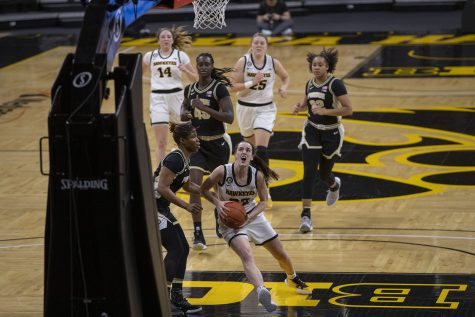 Iowa guard Caitlin Clark goes for a layup during a women