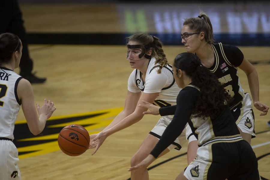 Iowa guard Kate Martin passes the ball during a women's basketball game against Purdue on Monday, Jan. 18, 2021 at Carver Hawkeye Arena. The Hawkeyes defeated the Boilermakers 87-81.