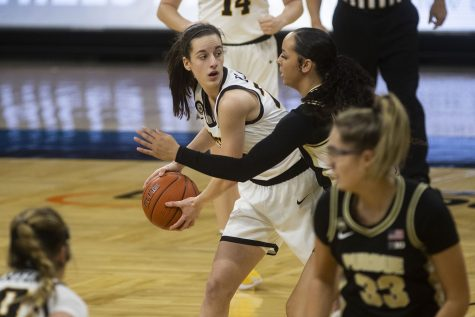 Iowa guard Caitlin Clark looks to pass the ball during a women