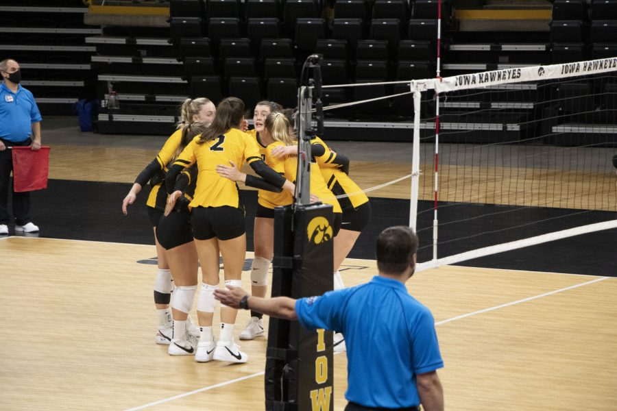 Iowa players huddle up after receiving the point volleyball match between Illinois and Iowa on Saturday Jan 23, 2021 at Carver Hawkeye Arena. The Hawkeyes were defeated by the Fighting Illini, 3-1.