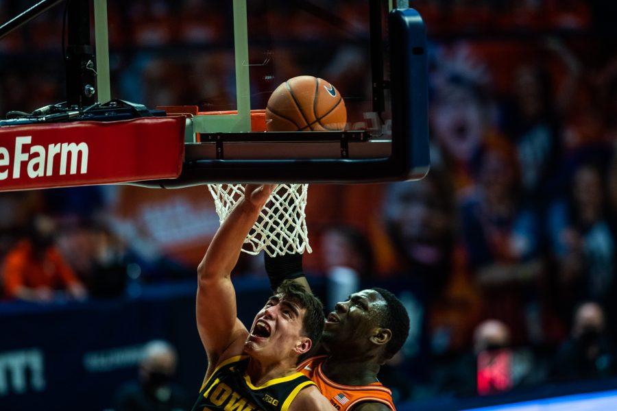 Friday, Jan. 29, 2021; Champaign, Illinois, USA; Iowa Center Luka Garza (55) takes a shot under the basket during the Iowa v. Illinois basketball game at State Farm Center. Kate Heston/Daily Iowan