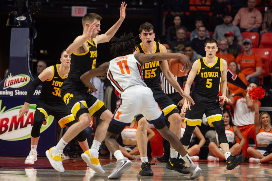 Iowa basketball players (left to right) Connor McCaffery, Joe Wieskamp, Luka Garza, and C.J. Fredrick block Illinois guard Ayo Dosunmu from shooting a basket during a game against the University of Illinois on Sunday, March 8, 2020, at the State Farm Center in Champaign, Ill. The Hawkeyes lost to the Fighting Illini, 76-78. (Emily Wangen/The Daily Iowan)