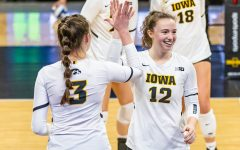 Iowa Outside Hitter Audrey Black and Iowa Setter Bailey Ortega high five one another during the Iowa Volleyball season opener game against Illinois on Jan. 22, 2021 at Carver-Hawkeye Arena. Illinois defeated Iowa 3-1.