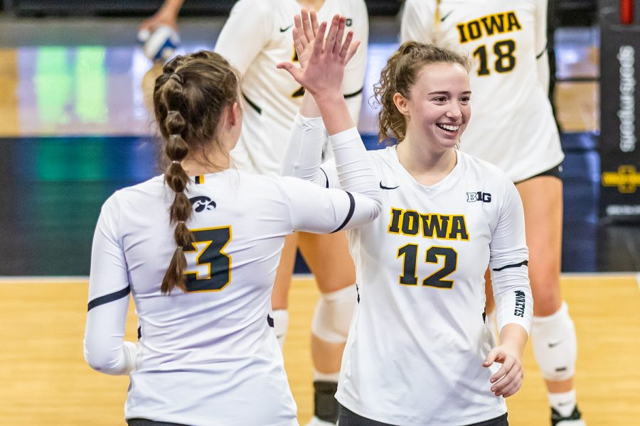 Iowa+Outside+Hitter+Audrey+Black+and+Iowa+Setter+Bailey+Ortega+high+five+one+another+during+the+Iowa+Volleyball+season+opener+game+against+Illinois+on+Jan.+22%2C+2021+at+Carver-Hawkeye+Arena.+Illinois+defeated+Iowa+3-1.+