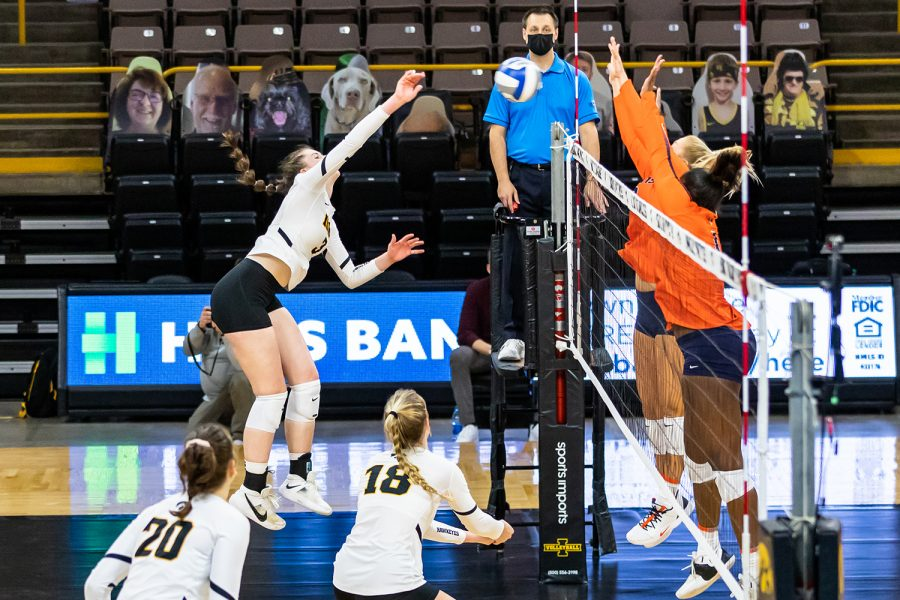 Iowa Outside Hitter Audrey Black hits the ball over the net during the Iowa Volleyball season opener game against Illinois on Jan. 22, 2021 at Carver-Hawkeye Arena. Illinois defeated Iowa 3-1.