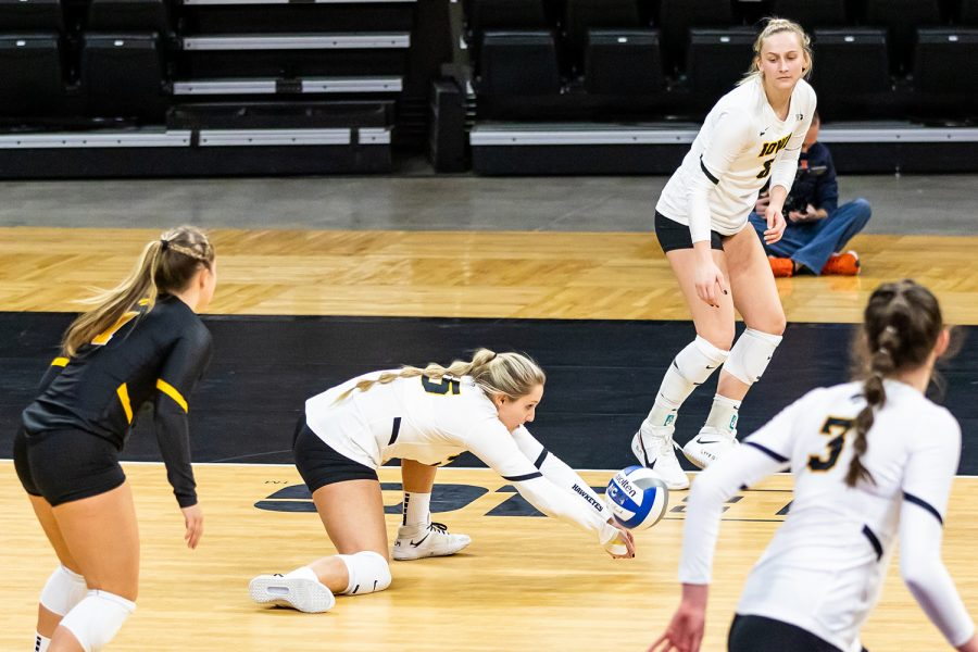 Iowa Defensive Specialist Maggie Slagle dives for the ball during the Iowa Volleyball season opener game against Illinois on Jan. 22, 2021 at Carver-Hawkeye Arena. Illinois defeated Iowa 3-1.