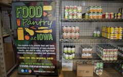 Can goods slowly fill the shelf at the U of Iowa food pantry, on Friday, Jan 22, 2021.