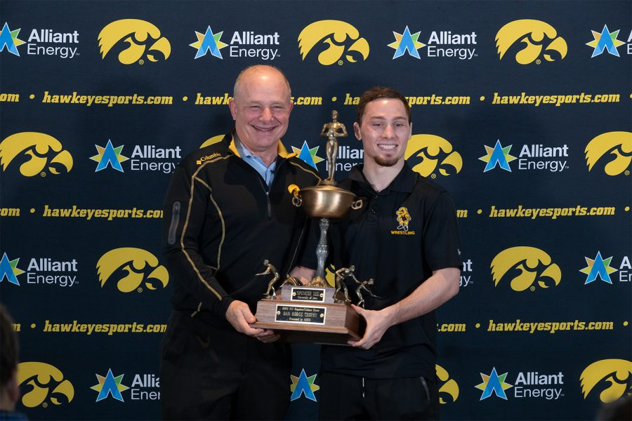 Iowa wrestler Spencer Lee holds the Hodge Trophy with his father, Larry at Kinnick Stadium on Jan. 5, 2021. The Hodge Trophy is awarded to the best wrestler in the nation and Lee is one of three Hawkeyes to win the award.