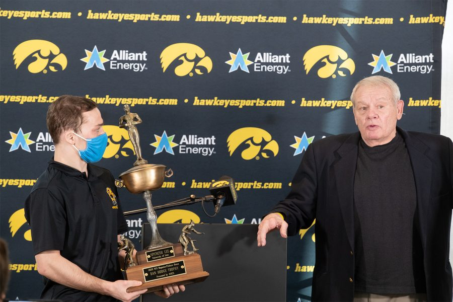 Iowa wrestler Spencer Lee holds the Hodge Trophy at Kinnick Stadium on January 5 2021. The Hodge Trophy is awarded to the best wrestler in the nation and Lee is one of three Hawkeyes to win the award.