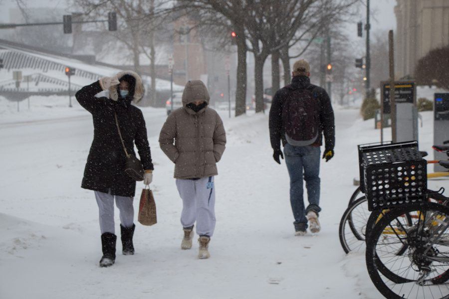 Students are seen walking to and from class in the snow at the University of Iowa on Monday, Jan. 25, 2021.