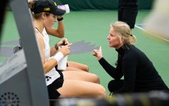 Iowa head coach Sasha Schmid talks to her team during a women's tennis match between Iowa and Colorado at the HTRC on Sunday, Feb. 16, 2020.
