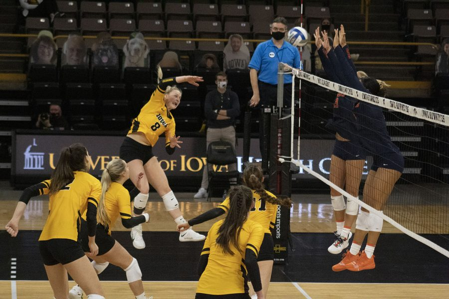 Kyndra Hansen spikes the ball toward Illinois during the volleyball match between Illinois and Iowa on Saturday Jan 23, 2021, at Carver-Hawkeye Arena. Illinois beat the Hawkeyes 3:1.