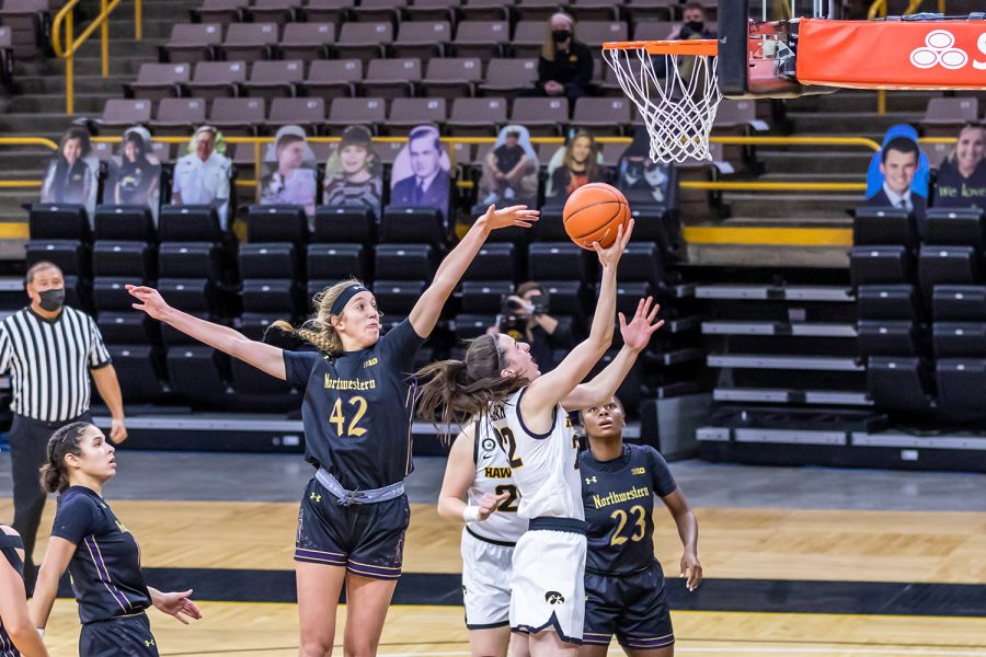 Iowa Guard Caitlin Clark goes in for a layup during the Iowa Women's Basketball game against Northwestern on Jan. 28, 2021 at Carver-Hawkeye Arena. Northwestern defeated Iowa 87-80