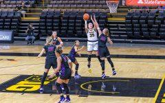 Iowa's Forward/Center Monika Czinano shoots the ball during the Iowa Hawkeyes Women's Basketball season opener against Northern Iowa on Nov. 25, 2020 at The Carver-Hawkeye Arena. The Iowa Hawkeyes defeated Northern Iowa 96-81. (Casey Stone/The Daily Iowan)