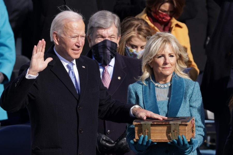Joe Biden is sworn in as U.S. President during his inauguration on the West Front of the U.S. Capitol on January 20, 2021, in Washington, DC. During today's inauguration ceremony Joe Biden becomes the 46th president of the United States. (Alex Wong/Getty Images/TNS)