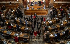 Legislative members and attendees applaud as Kim Reynolds exits the house chamber following the State of the State address in the Iowa State Capitol on Tuesday, Jan. 12, 2021 in Des Moines. Gov. Reynolds highlighted in the address expansion of broadband internet, a push for in-person learning, and economic recovery from the COVID-19 pandemic.