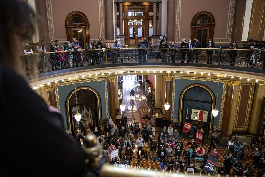 Anti-mask protesters stand in the rotunda of the Iowa State Capitol building before the opening of the 2021 legislative session on Monday, Jan. 11, 2021. Despite Gov. Kim Reynold's emergency proclamation mandating masks worn when social distancing indoors is not possible, house republicans made the announcement last week that masks would not be required during the session.