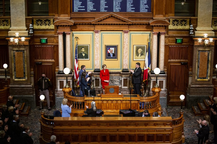 Attendees applaud Gov. Kim Reynolds during the State of the State address in the house chamber of the Iowa State Capitol on Tuesday, Jan. 12, 2021 in Des Moines. Gov. Reynolds highlighted in the address expansion of broadband internet, a push for in-person learning, and economic recovery from the COVID-19 pandemic.