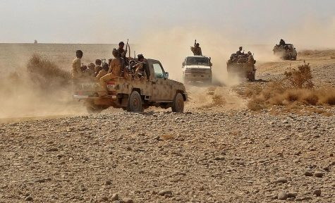 Fighters ride in pickup trucks as forces loyal to Yemen