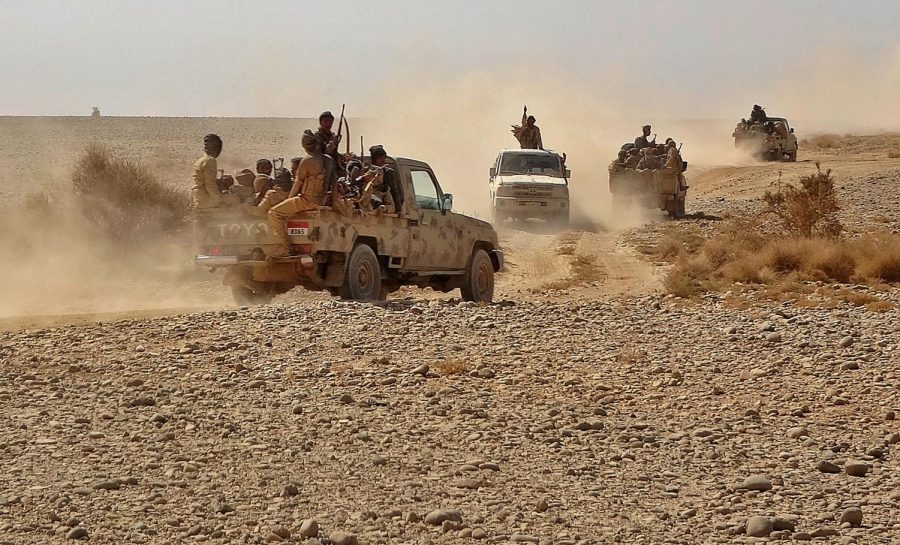 Fighters+ride+in+pickup+trucks+as+forces+loyal+to+Yemen%27s+Saudi-backed+government+clash+with+Huthi+rebel+fighters+around+the+strategic+government-held+%22Mas+Camp%22+military+base%2C+in+the+al-Jadaan+area+about+50+kilometers+northwest+of+Marib+in+central+Yemen%2C+on+November+22%2C+2020.