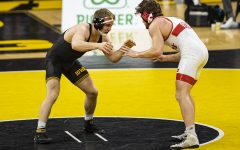 IowaÕs 184-pound Nelson Brands grapples with NebraskaÕs Taylor Venz during a wrestling dual meet between No. 1 Iowa and No. 6 Nebraska at Carver Hawkeye Arena on Friday, Jan. 15, 2021.