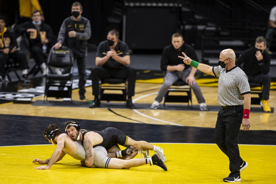 IowaÕs 141-pound Jaydin Eierman grapples with IllinoisÕ Dylan Duncan during a wrestling dual meet between Iowa and Illinois at Carver-Hawkeye Arena on Sunday, Jan. 31, 2021. No. 1 Eierman defeated No. 13 Duncan by tech fall in 6:05.