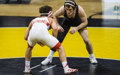 IowaÕs 125-pound Spencer Lee grapples with NebraskaÕs Liam Cronin during a wrestling dual meet between No. 1 Iowa and No. 6 Nebraska at Carver Hawkeye Arena on Friday, Jan. 15, 2021.