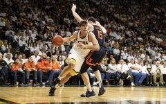 Iowa center Luka Garza attempts to push past Illinois forward Giorgi Bezhanishvili during a men's basketball game between the Iowa Hawkeyes and the Illinois Fighting Illini on Sunday, February 2, 2020. The Hawkeyes defeated the Fighting Illini 72-65.