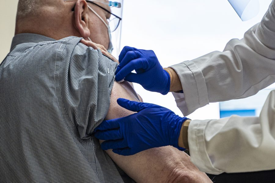 Doctors prepare to administer a COVID-19 vaccine at the VA Medical Center in Iowa City on Tuesday, Dec. 22, 2020. The center received the Modern vaccine for its employees.