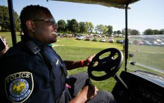 University of Iowa Police Officer Alton Poole wears his VIEVU LE2 Body Worn Video Camera as he patrols the Finkbine Golf Course tailgating lot before Iowa's game against Northern Iowa Saturday, Sept. 15, 2012 in Iowa City. The University of Iowa has outfitted all 43 of their police officers and 18 members of their security staff with the cameras at a cost of $899 each.