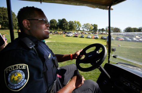 University of Iowa Police Officer Alton Poole wears his VIEVU LE2 Body Worn Video Camera as he patrols the Finkbine Golf Course tailgating lot before Iowa