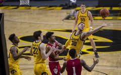 Iowa guard Connor McCaffery reaches for a rebound during a men's basketball game against Indiana on Thursday, Jan. 21, 2021 at Carver Hawkeye Arena. The Hawkeyes were defeated by the Hoosiers, 69-81.