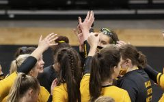 Teammates huddle up during a timeout at the volleyball game against Illinois on Saturday Jan. 23, 2020, at Carver Hawkeye Arena. The Hawkeyes were defeated by the Fighting Illini, 3-1.