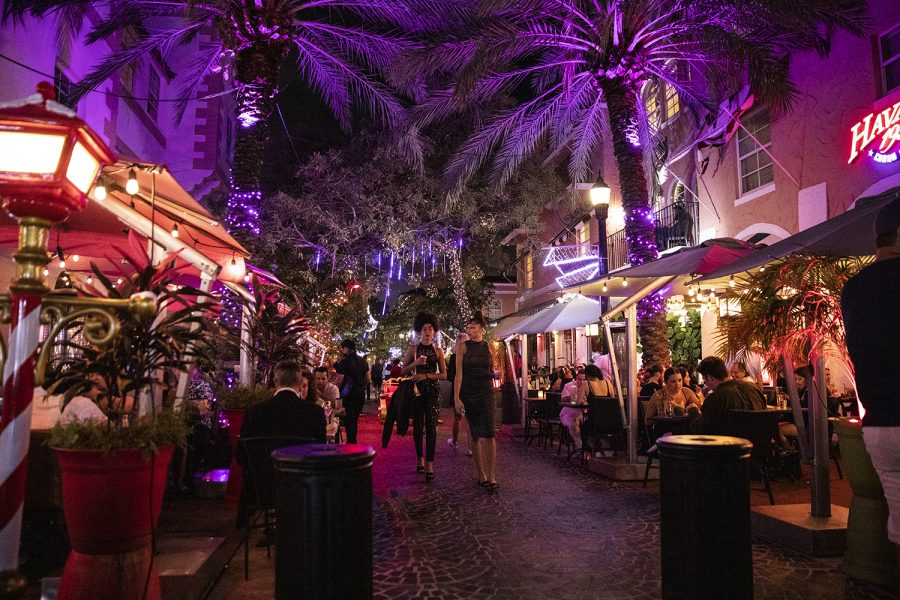 Pedestrians walk through a pedestrian mall next to Espanola Way in downtown Miami Beach, Florida on Thursday, Dec. 31, 2020. While some New Years traditions to the Miami area were canceled due to concerns of the COVID-19 virus, downtown Miami still had crowds gathered for celebration.