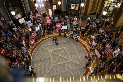 Anti-mask protestors stand in the rotunda of the Iowa State Capitol Building before the opening of the legislative session on Monday, Jan. 11, 2021. (Ryan Adams/The Daily Iowan)