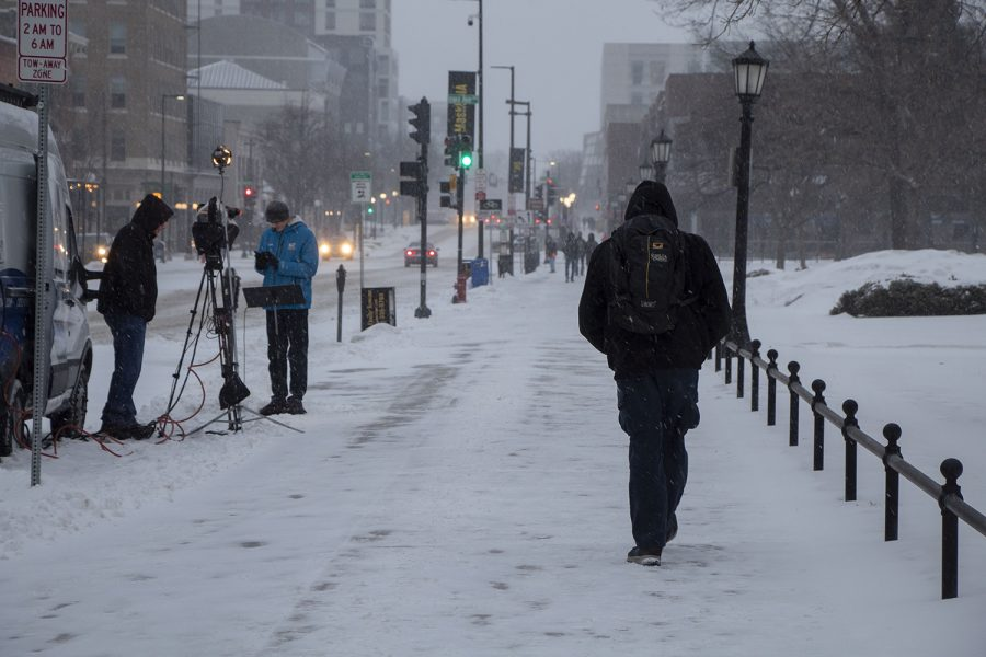 Students+are+seen+walking+to+and+from+class+in+the+snow+while+a+reporter+and+cameraman+set+up+equipment+at+the+University+of+Iowa+on+Monday%2C+Jan.+25%2C+2021.+%28Grace+Smith%2FThe+Daily+Iowan%29