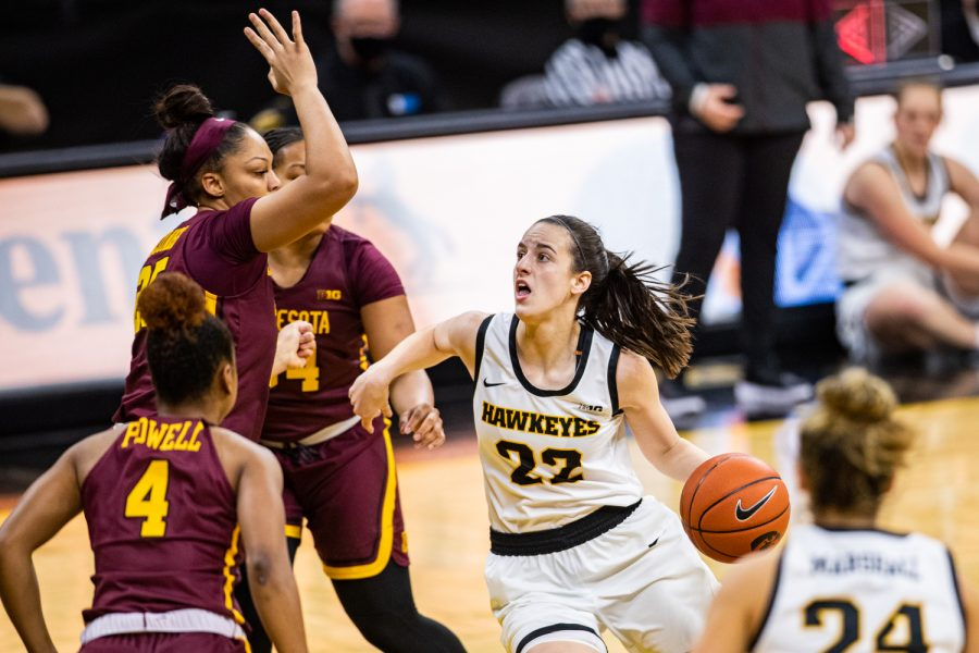 Iowa guard Caitlin Clark drives to the rim during a women's basketball game between Iowa and Minnesota on Wednesday.