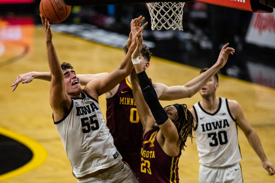 Iowa forward Luka Garza lays the ball up during a men's basketball game between Iowa and Minnesota at Carver-Hawkeye Arena on Sunday, Jan. 10, 2021. The Hawkeyes defeated the Golden Gophers, 86-71.