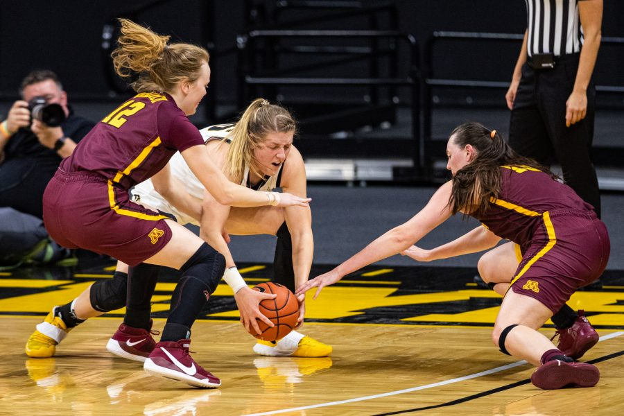 Players+dive+for+the+ball+during+a+women%27s+basketball+game+between+Iowa+and+Minnesota+at+Carver-Hawkeye+Arena+on+Wednesday%2C+Jan.+6%2C+2021.+The+Hawkeyes+defeated+the+Golden+Gophers%2C+92-79.