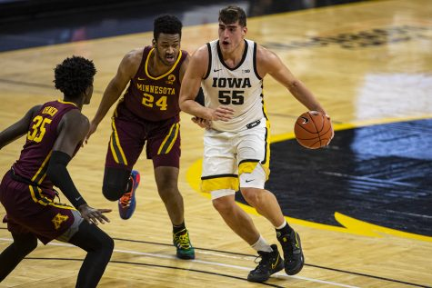 Iowa forward Luka Garza dribbles during a men